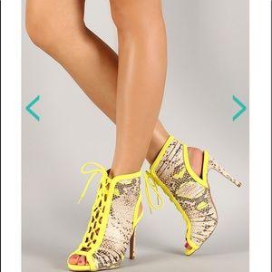 Yellow snake skin shoes
